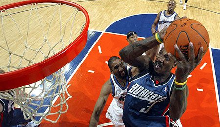 The Charlotte Bobcats have re-signed small forward Gerald Wallace.