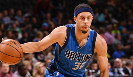 Seth Curry is driving for the Dallas Mavericks.